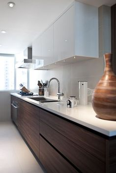 :: KITCHENS :: simple galley kitchen in white & black walnut #kitchens
