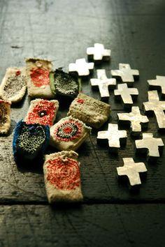 Clay cross in a handmade bad.