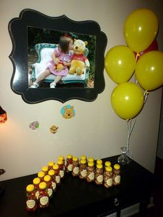 Pooh birthday party favors - use cheap bear containers from bee supply store, fill with gummy bears or teddy grahams