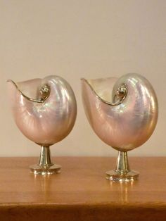 This beautiful pair of nautilus shells are mounted on silver plated stands. Each has its edge coated in silver. Their pearly smooth surface is exquisite. 2018 Interior Design Trends, Nautilus Shell, French Antiques, Vintage Furniture, Silver Plate, Shells, Pearl Earrings, Pairs, Beach House