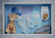 Cute way to display your baby mementoes - shadow box memory frame