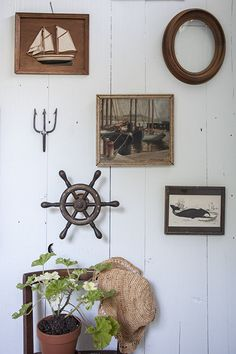 Great nautical gallery wall with mini ship wheel! http://www.completely-coastal.com/2015/03/Sag-Harbor-home-nautical-decorations.html