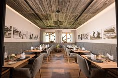 Pleasant atmosphere in this beautiful dining area at Bergwiesenglück in Tyrol with our Oak Lapis FLOORs and ACOUSTIC elements and reclaimed wood panels in sunbaked grey Hotel Interiors, Wood Paneling, Dining Area, Flooring, Acoustic, Table, Furniture, Grey, Home Decor