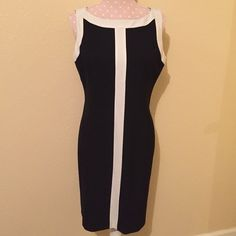 INC Dress INC black and off-white colored dress, size 10. Very flattering and comfortable. Only worn a few times and has been freshly dry cleaned. Please do not hesitate to ask questions  INC International Concepts Dresses Midi
