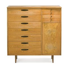 George Nakashima; Walnut, Elm and Brass Dresser for Widdicomb, 1950s.