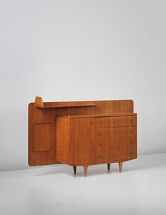 PHILLIPS : UK050314, Gio Ponti, Rare sideboard with integrated shelf