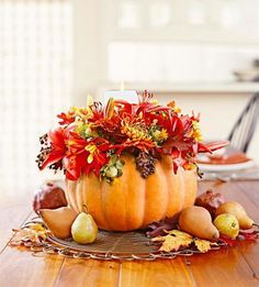 """A pumpkin """"basket"""" makes an imaginative centerpiece for a Thanksgiving table. More decorating ideas: http://www.midwestliving.com/holidays/thanksgiving/easy-ideas-for-thanksgiving-decorating/?page=14,0"""