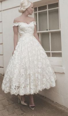 Off-the-shoulder lace tea-length wedding dress; Featured Dress: House of Mooshki