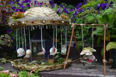 Miniature garden fairy-go-round - Fairies like to have fun too! I love the swing as well.