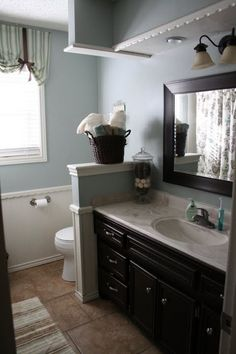black cabinet bathroom - oil rubbed bronze fixtures - blue walls - I would love the walls to be a tad brighter but besides that, I love this.