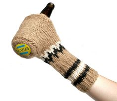 Sküüzi is a handmade glove/koozie hybrid that keeps your beer cold and your hands warm with 100% merino wool.
