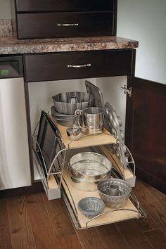 """No more rummaging in the dark or searching through stacks of pans. The Base Pots and Pans Pull-out cabinet is available in 24"""" and 30"""" widths."""