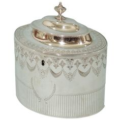 View this item and discover similar for sale at - A George III sterling oval lidded tea caddy with bright cut decoration and an armorial in the form of a crane. Tea Tins, Tea Strainer, Tea Caddy, Tea Service, Vintage Silver, Antique Silver, My Tea, Tea Accessories, Drinking Tea