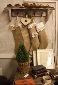 Lace & burlap ... If you don't have a mantel, use a shelf with pegs!