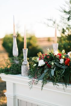 Fireplace Mantle Candles Foliage Red Rose Berries Flowers Swag Garland Christmas Tree Farm Wedding Ideas http://loriblythe.com/