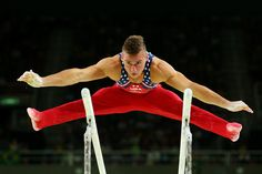. RIO DE JANEIRO, BRAZIL - AUGUST 08:  Samuel Mikulak of the United States competes on the parallel bars during the men\'s team final on Day 3 of the Rio 2016 Olympic Games at the Rio Olympic Arena on August 8, 2016 in Rio de Janeiro, Brazil.  (Photo by Alex Livesey/Getty Images)