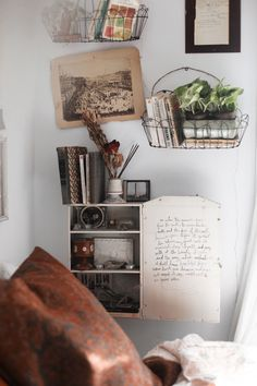 I love the metal basket hanging with fresh little plants and books! | About A Girl: Kellyn & Nikki Home Photo Tour | Free People Blog