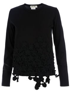 Comme des Garcons black cotton sweater from with  round neck, long sleeves and tonal floral details on the front.