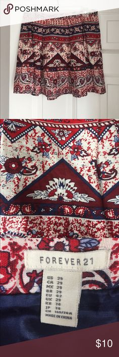 Forever21 Pleated Skirt Size 29 Forever 21 red white and blue skirt with floral designs and paisley filagrees. Perfect for a casual evening, work or the 4th of July! Shell 100% linen, lining 100% polyester. Forever 21 Skirts Mini