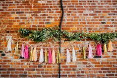 pink + gold tassel garlands, photo by Love Katie and Sarah http://ruffledblog.com/a-brooklyn-wedding-for-two-actors #weddingideas #garland #tassels