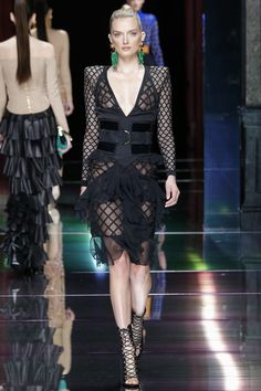Meet the fiercest duo - Balmain's S/S 2016 runway collection hearkens to an era of militaristic style with geometric patterns and larger hardware along with Gabriella Wimmer's Small Marquise metal clutch with hand-shaped bronze and chain. Watch out world!