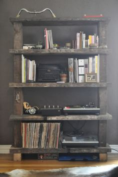 this is an awesome look for the man cave/music room - saw some scrap wood out by the road the other day that I could use for this.