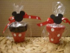 These are listed as candy holders/party favors, but would be cute larger as flower pots too!