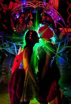 724b49ba1e5 Amazing Burning Man shot. Eskimo kiss ! Dig those LED light up sunglasses
