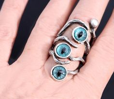 Purple Evil Eye Ring Dragon Eye Ring: This gorgeous silver branch ring has three hand painted evil eyes or dragon eye. I hand painted the eyes in beautiful purple hues. The dragon eye or evil eyes are set in bezels at the tip of a branch. The branches wrap around the finger and intertwine with the eyes on the other side. Nature inspired woodland ring. Unisex ring, mens ring, rings for women. Unique Evil Eye Ring Silver Branch Ring by DesignsBloom Eyes in the night silver branch ring…