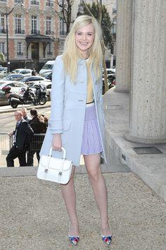 Arriving at the Miu Miu show in Paris during Fashion Week.    - ELLE.com