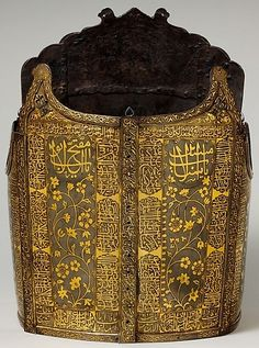 "Indo-Persian char-aina cuirass,  late 18th to 19th century, steel, gold, H. 15 1/2 in. (39.37 cm); Wt. 6 lb. 13, Met Museum. The Arabic inscriptions stress God as the God of Light, the rewards He will give His servants, and His punishment of unbelievers and evildoers. The light imagery is particulary appropriate for gold embellished armors of ""four mirror"" (char aina) type. (the museum says ""probably Indian"", but it looks Persian to me.)"