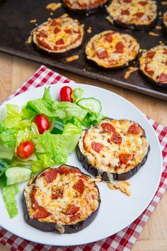 Eggplant Pizzas *One of my new favorites for a light lunch or dinner. I've made them a couple of times now when I want something cheesy and melty and saucy.*