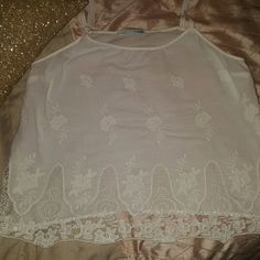 Maurices white top Embroidered white top. Very chic. Never worn Maurices Tops Blouses