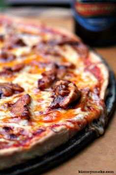 Buffalo Chicken Pizza Recipe- This recipe includes homemade pizza dough and grilled buffalo chicken. It all adds up to one seriously scrumptious grilled pizza! Get the recipe at kissmysmoke.com
