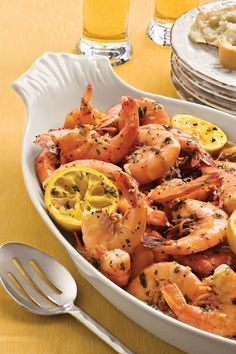 Beach Shrimp | Your family will love the fresh flavors of shrimp tacos, fish po'boys, grilled Greek snapper, and more. Whip up one of these recipes for dinner tonight. Enjoying seafood for dinner can be quick and simple. These easy seafood recipes make mealtimes a breeze and have you out of the kitchen and enjoying delicious seafood in a snap. Our Roasted Gulf Shrimp with Romesco Sauce only needs 10 minutes in the oven, and Poached Salmon can be ready in the same amount of time.