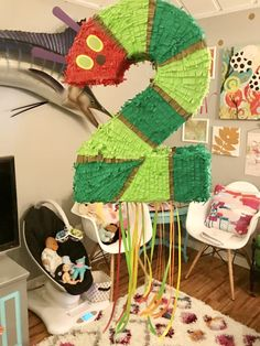 The Very Hungry Caterpillar Eric Carle birthday party ideas decorations DIY caterpillar 2 trapped door pinata