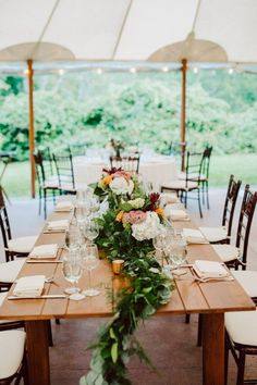Rustic tablescape -  farm table with white / blush/ red flowers and greenery runner centerpiece. Summer tent weddings in Massachusetts. Willowdale Estate is a wedding and events venue in New England. Willowdaleestate.com | Mark Spooner Photography