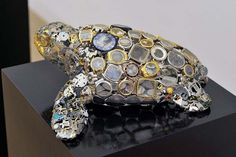 A tortoise made out of #recycled watches: http://inhabitat.com/natsumi-hondas-tortoise-and-hare-sculptures-are-made-from-recycled-watch-parts/natsumi-honda-recycled-watches-sculptures-tortoise-and-hare-2/