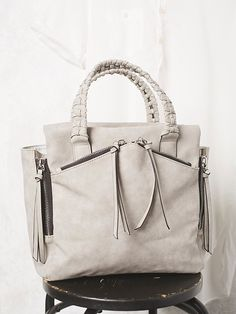 Holloway Vegan Tote | Vegan leather tote bag featuring exposed zipper detailing.  Zip top closure featuring zip and slip pockets.  Braided top handle and a long adjustable and removable long strap.