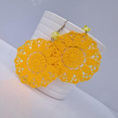 Maxi crochet earrings in lemon yellow cotton yarn with acrylic bead. Details: 100% extrafine cotton yarn Acrylic bead Width(crochet part): 7 cm Length (from the hook): 11 cm Every item is totally handmade. All products are designed and handmade by me, using high quality materials.