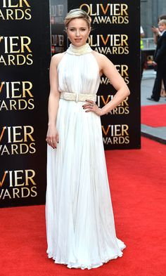 Dianna Agron was a vision in white attending the 2015 Olivier Awards in a floor-length Alexander McQueen gown with pearl embellishments at the collar and belt.