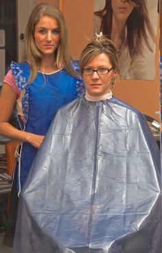 Long haired barberette has her client all caped up and neck stripped in preparation for an ultra short high and tight buzzcut:)