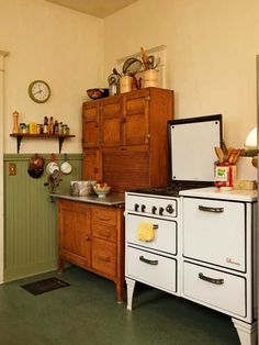 """The heavy, well-built 1930s stove is """"every bit as good"""" as the modern stainless range it replaced. The old Hoosier cabinet was $400 at auction."""