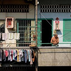A man on his #balcony in the Chợ Lớn (Chinatown) neighborhood of #Saigon (Ho Chi Minh city). South #Vietnam.  Photo by @jaimetaylor1978. ____ by ig_vietnam