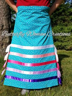 """For sale: Ribbon Skirt with purple, lavender, bright pink,  light pink and white ribbon on blue. Size 12-14 (jean size) and 37"""" inch length. Can be shortened a little. Comes with your initials embroidered on inside waistband. $65 plus shipping #ribbonskirts #native #nativepride #butterflywomancreations"""