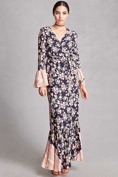 A woven maxi dress by Selfie Leslie™ featuring a self-tie wrap design, a floral print, long trumpet sleeves with contrast trim, and a partially ruffled back with contrast trim.