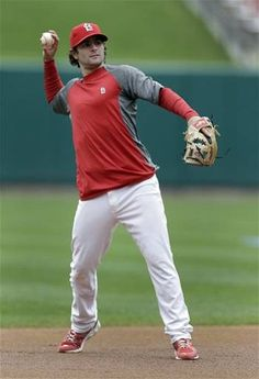 St. Louis Cardinals shortstop Pete Kozma throws a ball during baseball practice Saturday, Oct. 6, 2012, in St. Louis. The Cardinals and Washington Nationals are scheduled to play Game 1 in the National League division series on Sunday. (AP Photo/Jeff Roberson)