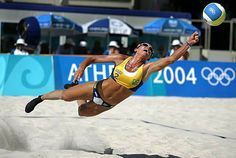 Sanda Pires leaps for a ball during her beach volleyball quarter-final defeat by compatriots Adriana Behar and Shelda Bede at the Athens 2004 Olympic Games on August 22.