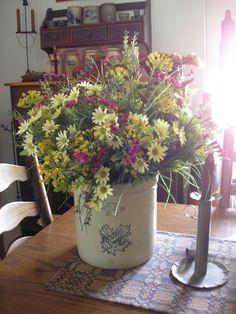 Prim spring crock of flowers