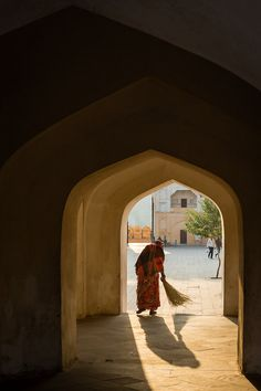 Amber Palace Sweeper by João Maia A woman sweeps an archway on the courtyard of Amber Palace. See more photos at: http://j.mp/1FCj9QO